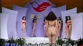 Blonde girl in red lingerie engulfing rod
