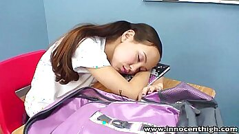 asian teen fingers her pussy on a table