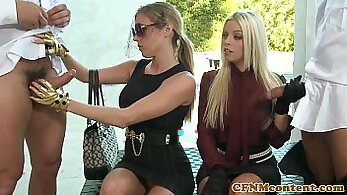 Clothed femdoms fucking on sofa